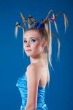 Schöne junge Frau mit Gesichtkunst Lizenzfreie Stockfotografie