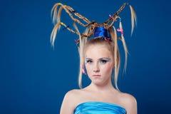 Schöne junge Frau mit Gesichtkunst Lizenzfreie Stockbilder