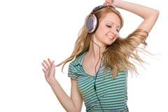 Schöne junge Frau mit Kopfhörern Lizenzfreie Stockfotografie