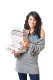 Schöne junge Frau mit Stapel Büchern Stockfotos