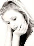 Schöne junge Frau mit traurigem Ausdruck Stockfotos