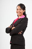 Schöne junge Geschäftsfrau bewaffnet das gefaltete Lächeln Stockbilder