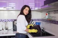 Schöne junge Hausfrau Stockfotografie