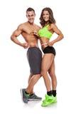 Schöne junge sportliche Paare mit einem messenden Band Lizenzfreie Stockfotografie