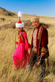 Schöne Kazakhfrau und -mann im nationalen Kostüm Lizenzfreie Stockfotos