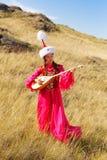 Schöne Kazakhfrau und -mann im nationalen Kostüm Lizenzfreies Stockbild