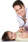 Schöne Krankenschwester mit Kind Stockfoto
