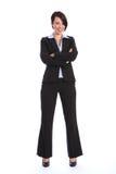 Schöne lächelnde junge Geschäftsfrau in der Klage Stockbilder