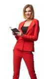 Schöne lächelnde tragende Schauspiele der Geschäftsfrau und im r lizenzfreies stockbild