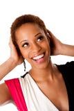 Schöne lachende afrikanische Geschäftsfrau Stockfoto