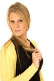 Schöne lange blonde behaarte Frau, die über Schulter mit ha schaut Lizenzfreie Stockfotografie
