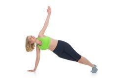 Schöne mittlere Greisin, die Sportübung tut Stockbilder