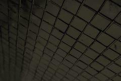 Schöne Nahaufnahme masert abstrakte Fliesen und dunklen schwarzen Farbglasmusterwandhintergrund und Kunsttapete stockfotos