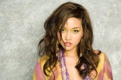 Schöne reizvolle asiatische Frau Stockbild