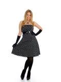 Schöne reizvolle Frau in der Stellung des eleganten Kleides Lizenzfreies Stockfoto