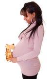 Schöne schwangere junge Afroamerikanerfrau Stockfoto