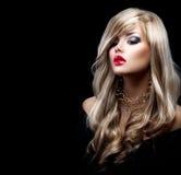 Schöne sexy blonde Frau mit dem langen Haar Stockbild