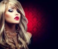 Schöne sexy blonde Frau mit dem langen Haar Stockfotografie