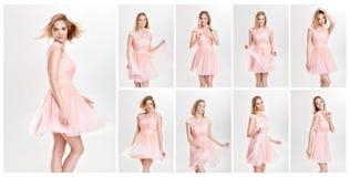 Schöne sinnliche und sexy blonde Frau im rosa Cocktailkleid PO Stockfoto