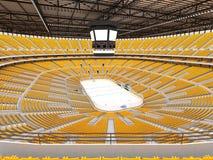 Schöne Sportarena für Eishockey mit gelben Sitzen und Promi-Kästen Lizenzfreie Stockfotografie