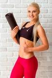 Schöne starke Sportlerin Stockbilder