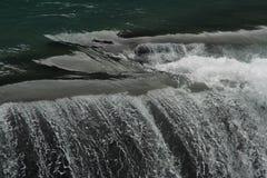 Schöne Steaks im Wasserfall Stockfotos