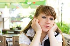 Schöne traurige Frau Stockbild