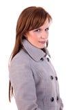 Schöne und glückliche Mittleralter Frau mit einem Mantel lizenzfreies stockbild
