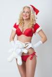 Schöne und sexy Frau kleidet als sexy Weihnachtsmann an Stockfoto