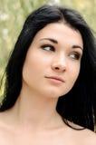 Schöne unterhaltene junge Frau Stockbilder