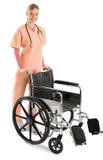 Schöne weibliche Krankenschwester With Wheelchair lizenzfreie stockbilder
