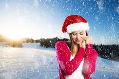 Schöne Weihnachtsfrau Stockfoto