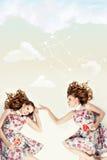 Schöne Zwillinge. Kreative Collage. stockbild