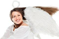 Schöner blonder Engel gegen weißen Hintergrund Lizenzfreie Stockfotografie