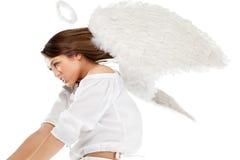 Schöner blonder Engel gegen weißen Hintergrund Lizenzfreies Stockfoto