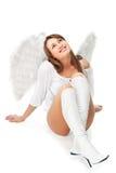 Schöner blonder Engel gegen weißen Hintergrund Stockbilder
