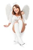 Schöner blonder Engel gegen weißen Hintergrund Stockfotografie