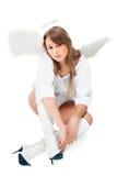 Schöner blonder Engel gegen weißen Hintergrund Stockfotos