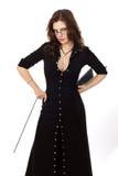 Schöner Brunette in einem schwarzen Kleid Stockfotos