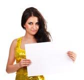 Schöner Brunette mit einem leeren Blatt des Papiers Lizenzfreie Stockbilder