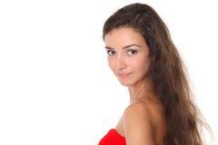 Schöner Brunette schaut über ihrer Schulter Lizenzfreies Stockfoto