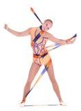 Schöner flexibler Mädchenturner mit einem gymnastischen Band stockfotos