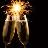 Schöner goldener Champagner mit Wunderkerzen - schwarzes Quadrat Lizenzfreie Stockfotografie