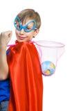 Schöner Junge gekleidet als Supermann, der die Erde rettet Lizenzfreie Stockfotografie
