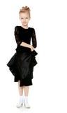 Schöner kleiner Tänzer in einem schwarzen Kleid Lizenzfreie Stockbilder