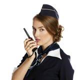 Schöner lächelnder Stewardess mit Columbiumradio Stockfoto