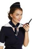Schöner lächelnder Stewardess mit Columbiumradio Lizenzfreies Stockbild