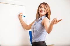 Schöner Lehrer, der eine Frage stellt Lizenzfreies Stockbild