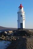Leuchtturm auf Küste Stockfoto
