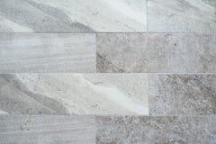 Schöner Marmorstein deckt Hintergrund mit Ziegeln Stockbild